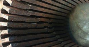 Drehstromstator neu gewickelt - dazu Ergänzend wurden Bleche neu gerichtet hier der Stator innen mit den verschobenen Blechen verschobenen Statornuten